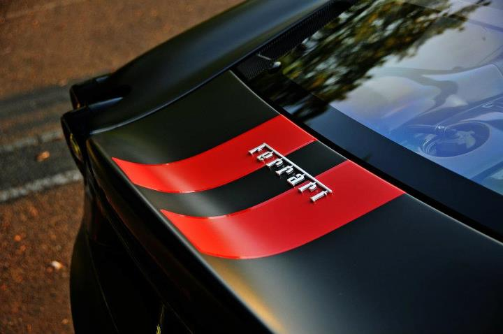 NorthWest Auto Salon installs red Scuderia stripes on a matte black Ferrari F430